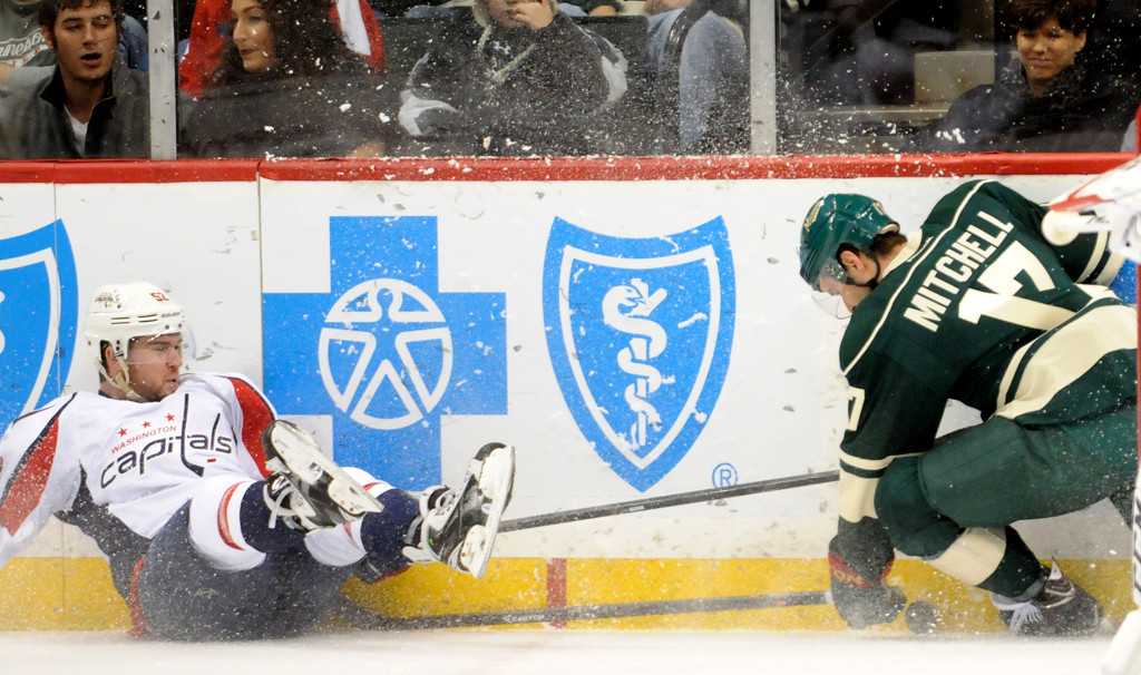 . Washington Capitals  Mike Green collides with Minnesota Wild Torrey Mitchell  during the first period. (Pioneer Press: Sherri LaRose-Chiglo)