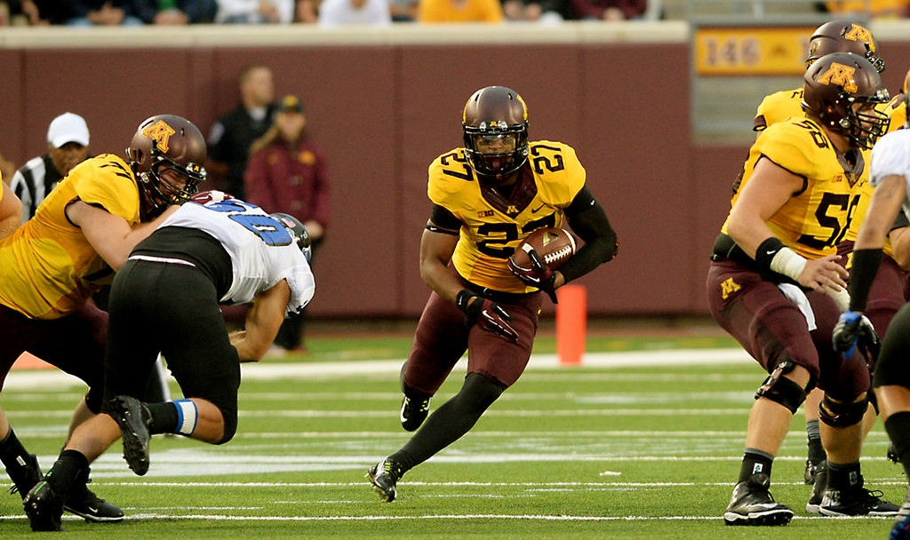 . Minnesota running back David Cobb finds a big hole to run through in the second quarter.  (Pioneer Press: John Autey)