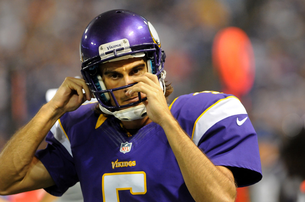 . Vikings punter Chris Kluwe secures his helmet during Minnesota\'s preseason game against the San Diego Chargers on Aug. 24, 2012, at the Metrodome in Minneapolis. (Pioneer Press: Jean Pieri)