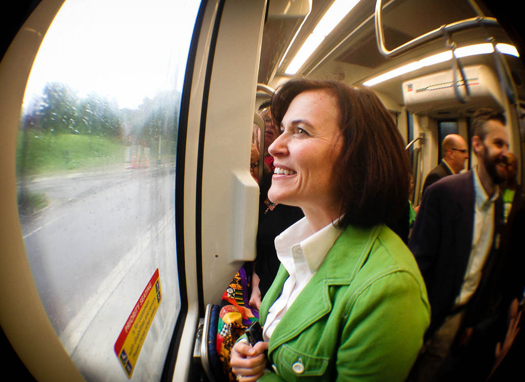 """. \""""I\'m beside myself,\"""" said Minneapolis mayor Betsy Hodges as she rode her first train on opening day of the Metro Transit Green Line light rail train in St. Paul .  (Pioneer Press: Ben Garvin)"""