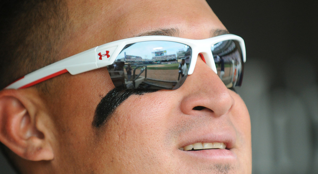 . Target Field is reflected in Oswaldo Arcia\'s sunglasses from the Twins\' dugout during the seventh inning. (Pioneer Press: John Autey)
