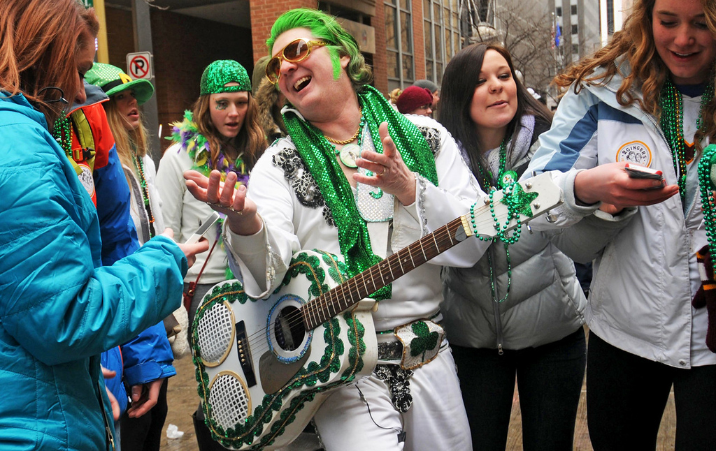 ". ""Irish Elvis,\"" a.k.a. Robert Klick of Golden Valley, charms his many admirers, who crowded in for a series of selfies, during the annual St. Patrick\'s Day parade. It was Klick\'s 13th year marching in the parade.  (Pioneer Press: Scott Takushi)"