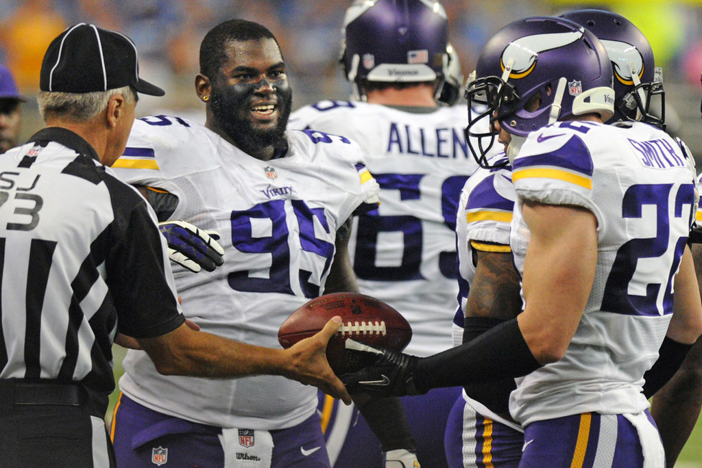 . Vikings defensive tackle Sharrif Floyd, left, smiles at free safety Harrison Smith, right, after Smith\'s fumble recovery in the second quarter against the Lions.  (Pioneer Press: Chris Polydoroff)