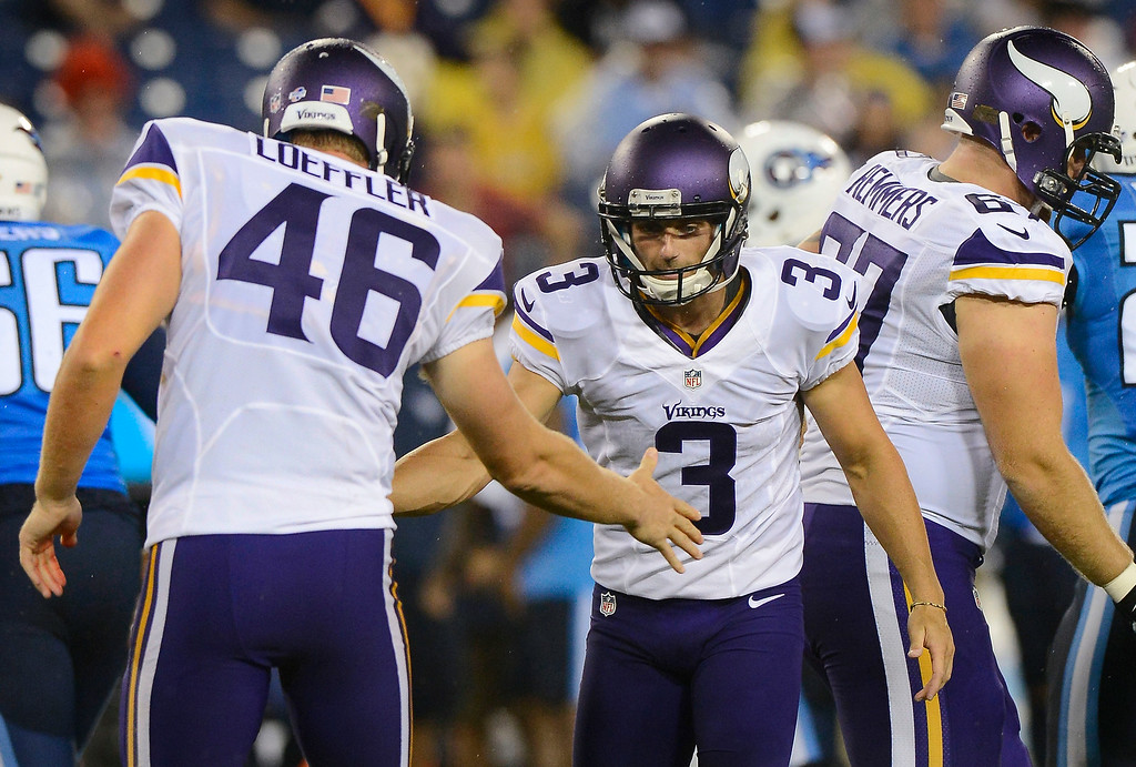 . Minnesota Vikings kicker Blair Walsh is congratulated by long snapper Cullen Loeffler after Walsh kicked a 45-yard field goal against the Tennessee Titans in the second quarter. (AP Photo/Mark Zaleski)