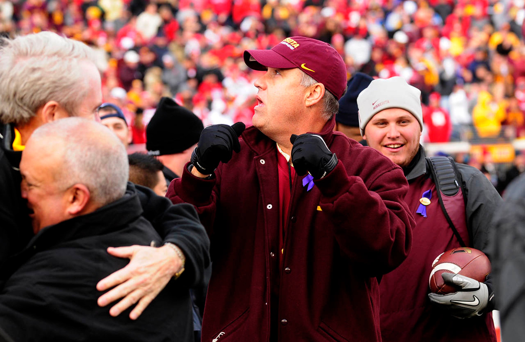. Minnesota\'s Athletic Director Norwood Teague celebrates as he watches the replay on the big screen of quarterback Philip Nelson\'s final touchdown. (Pioneer Press: Scott Takushi)