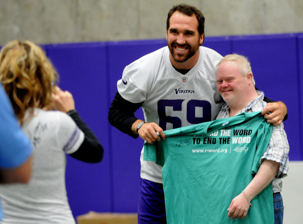 . Vikings defensive end Jared Allen is photographed with an athlete from the Minnesota Special Olympics after practice. (Pioneer Press: Jean Pieri)