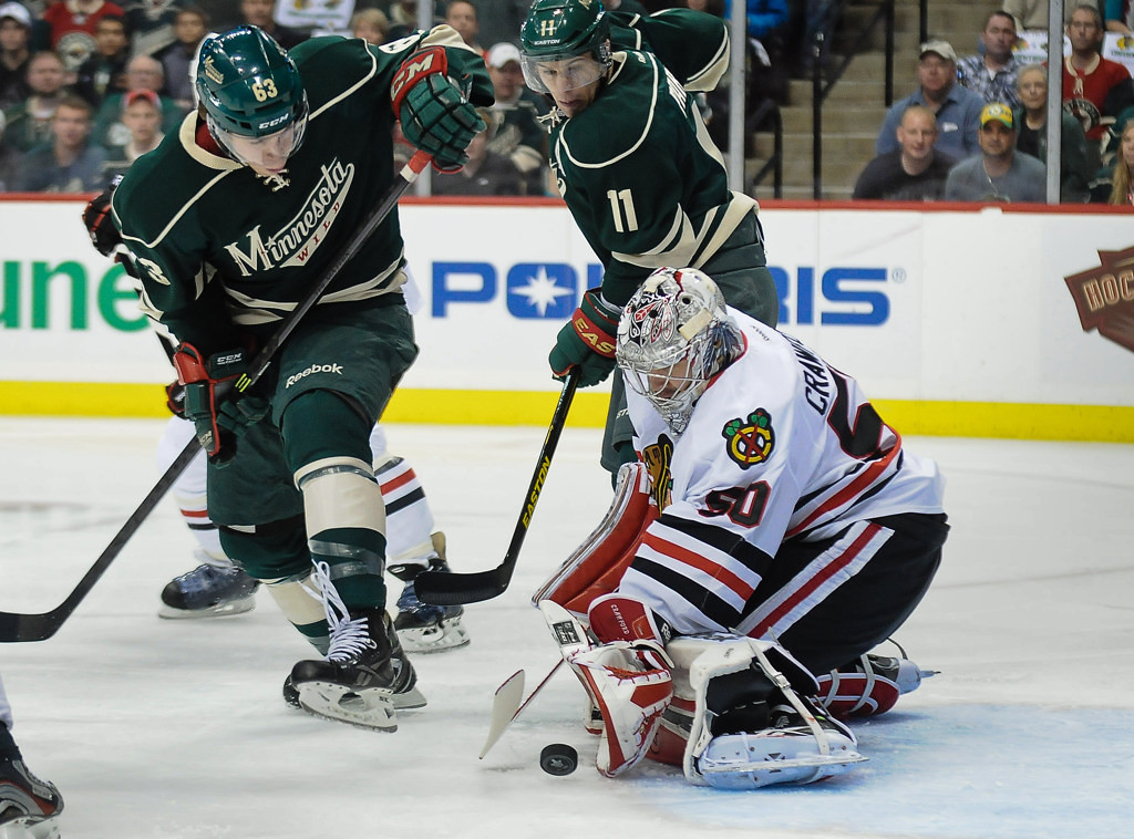 . Minnesota right wing Charlie Coyle, left, tries to score on Chicago goalie Corey Crawford in the first period. Winger Zach Parise hovers for the rebound. (Pioneer Press: Ben Garvin)