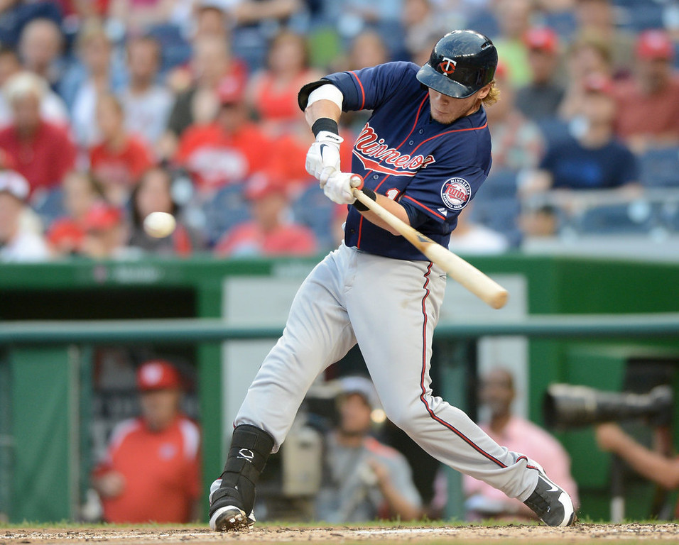 . Minnesota Twins catcher Chris Herrmann (12) connects on a 2-RBI double against the Washington Nationals in the second inning. (Chuck Myers/MCT)