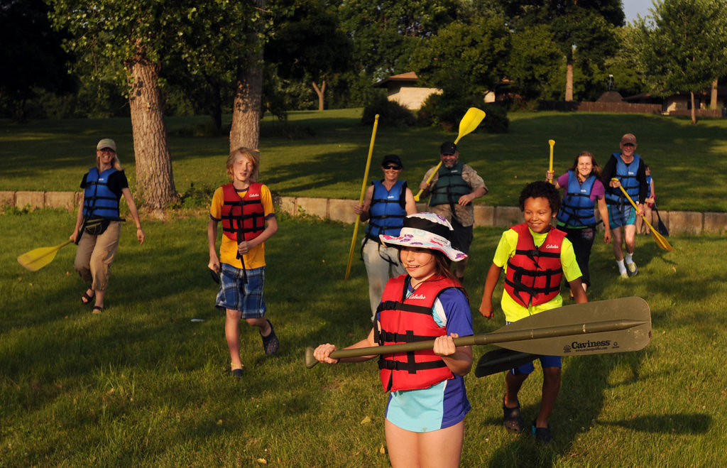 ". Participants in the ""I Can Paddle\"" program at Fort Snelling State Park play a game utilizing  common signals used by paddlers to stop and advance. (Pioneer Press: Chris Polydoroff)"