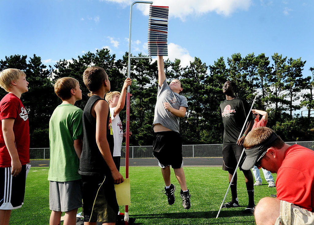. David Freeland, 11, takes his best shot at the vertical leap while other participants wait their turn. (Pioneer Press: Sherri LaRose-Chiglo)