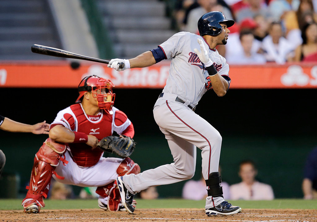 . Minnesota Twins\' Aaron Hicks hits an RBI double during the second inning of a baseball game against the Los Angeles Angels on Monday, July 22, 2013, in Anaheim, Calif. (AP Photo/Jae C. Hong)