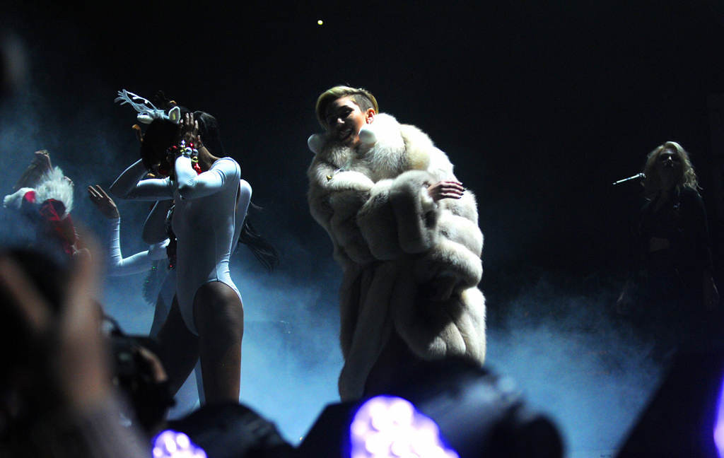 """. Miley Cyrus begins her opening song \""""Party in the USA\""""  at Xcel Energy Center in St. Paul, Tuesday, December 10, 2013. (Pioneer Press: Chris Polydoroff)"""