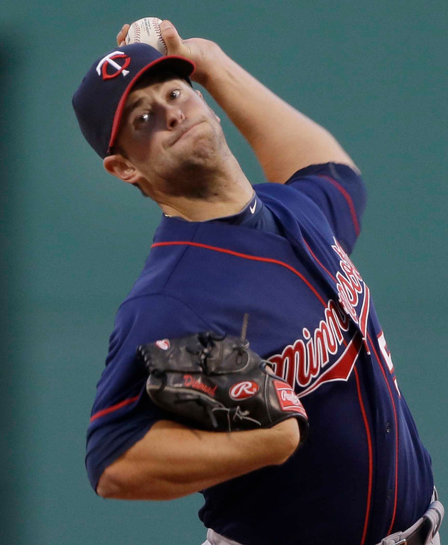 . Minnesota Twins starting pitcher Scott Diamond delivers to the Boston Red Sox during the first inning of a baseball game at Fenway Park in Boston, Tuesday, May 7, 2013. (AP Photo/Elise Amendola)