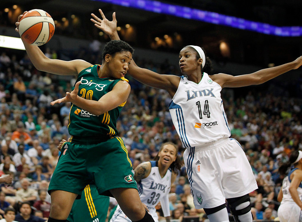 . Seattle Storm guard Tanisha Wright (30) grabs a rebound out of the air from Minnesota Lynx forward Devereaux Peters (14) in the first half of a WNBA basketball game, Sunday, Aug. 4, 2013, in Minneapolis. (AP Photo/Stacy Bengs)