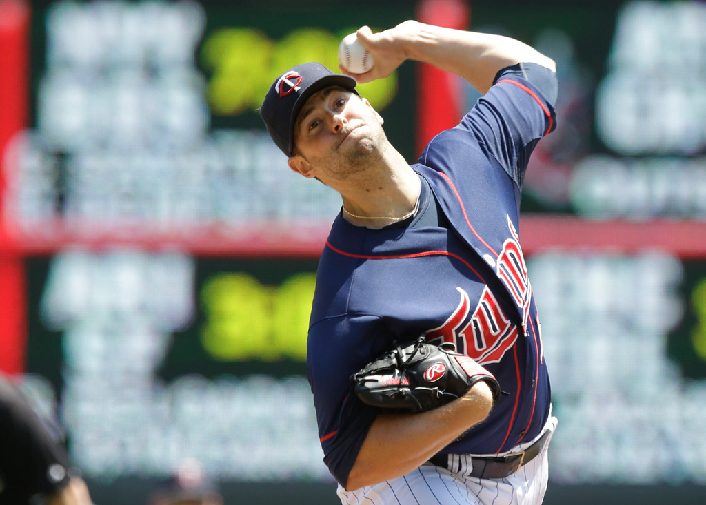 . Twins starter Scott Diamond throws against the Indians in the first inning. Diamond gave up five earned runs on seven hits over 4-2/3 innings in his ninth loss of the season.  (AP Photo/Jim Mone)