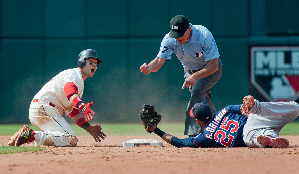 . Indians base runner Nick Swisher reacts as he is called out trying to stretch a single into a double by second base umpire John Hirschbeck as Twins shortstop Pedro Florimon holds on to the ball during the seventh inning.  (Photo by Jason Miller/Getty Images)