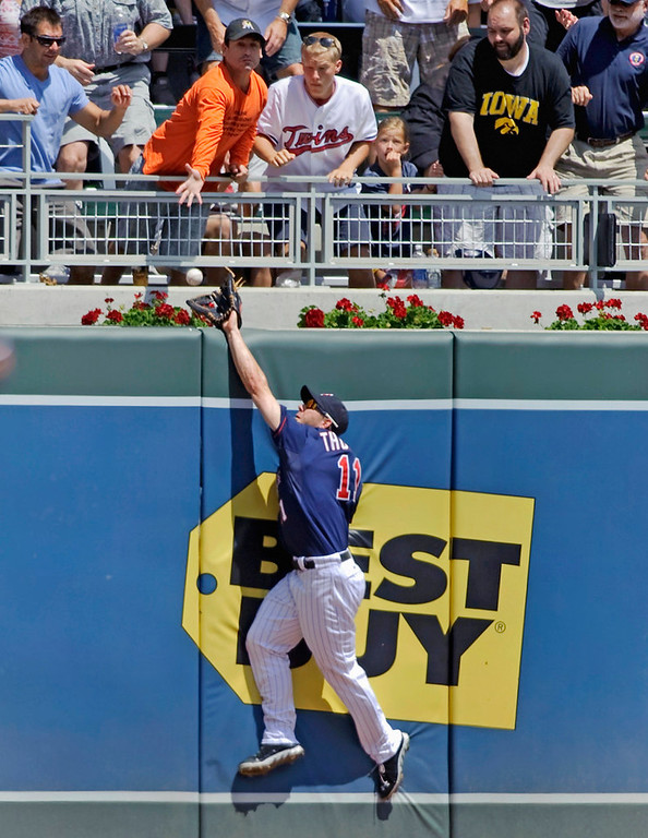 . Twins left fielder Clete Thomas just misses a catch on a two-run home run ball hit by Cleveland\'s Jason Kipnis during the third inning. (Photo by Hannah Foslien/Getty Images)