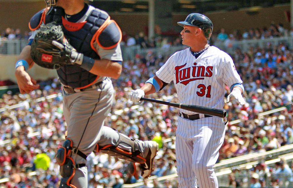 . Minnesota\'s Oswaldo Arcia reacts after striking out against Tigers starting pitcher Doug Fister as catcher Alex Avila, left, returns the ball during the fifth inning. (AP Photo/Genevieve Ross)