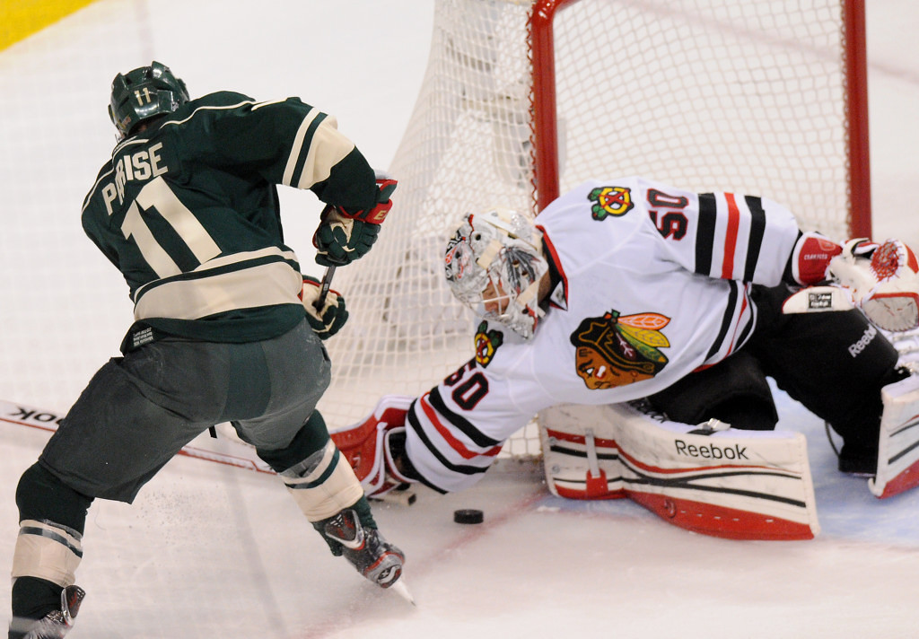 . Minnesota left wing Zach Parise tries to get a shot past Chicago goalie Corey Crawford in the first period. (Pioneer Press: John Autey)