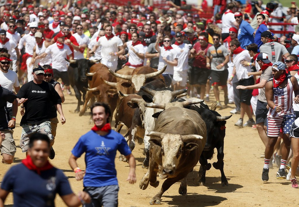 """. <p>7. (tie) RUNNING WITH BULLS  <p>At least the bulls were smart enough not to pay a $75 entry fee. (unranked) <p><b><a href=\'http://www.washingtonpost.com/local/drone-crashes-into-virginia-bull-run-crowd/2013/08/26/424e0b9e-0e00-11e3-85b6-d27422650fd5_story.html\' target=\""""_blank\""""> HUH?</a></b> <p>    (AP Photo/Richmond Times-Dispatch, Joe Mahoney)"""