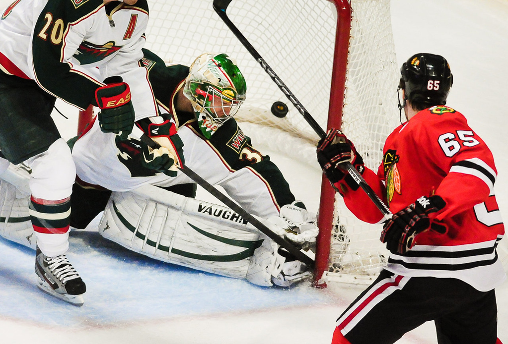 . Chicago center Andrew Shaw scores over the attempted block of Minnesota goalie Darcy Kuemper in the second period. (Pioneer Press: Ben Garvin)