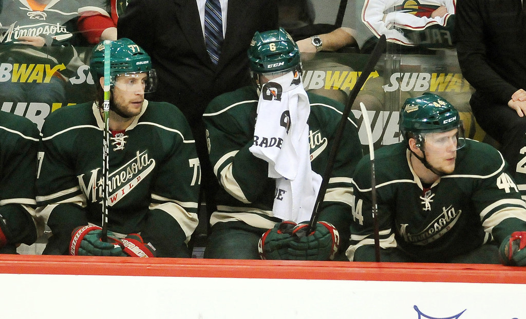 . Wild players (from left) Tom Gilbert, Marco Scandella and Justin Falk show their frustration on the bench late in the third period of Minnesota\'s 3-0 loss to the Chicago Blackhawks in Game 4 of their Western Conference quarterfinal game of the 2013 Stanley Cup playoffs at Xcel Energy Center in St. Paul on Tuesday May 7, 2013.  (Pioneer Press: Ben Garvin)