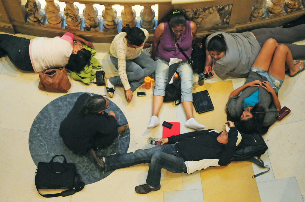""". A tired group of Latino activists rested near the rotunda after spending \""""all day, all night and all weekend\"""" at the state Capitol to push for the bill to allow undocumented immigrants to hold Minnesota driver\'s licenses. (Pioneer Press: Scott Takushi)"""