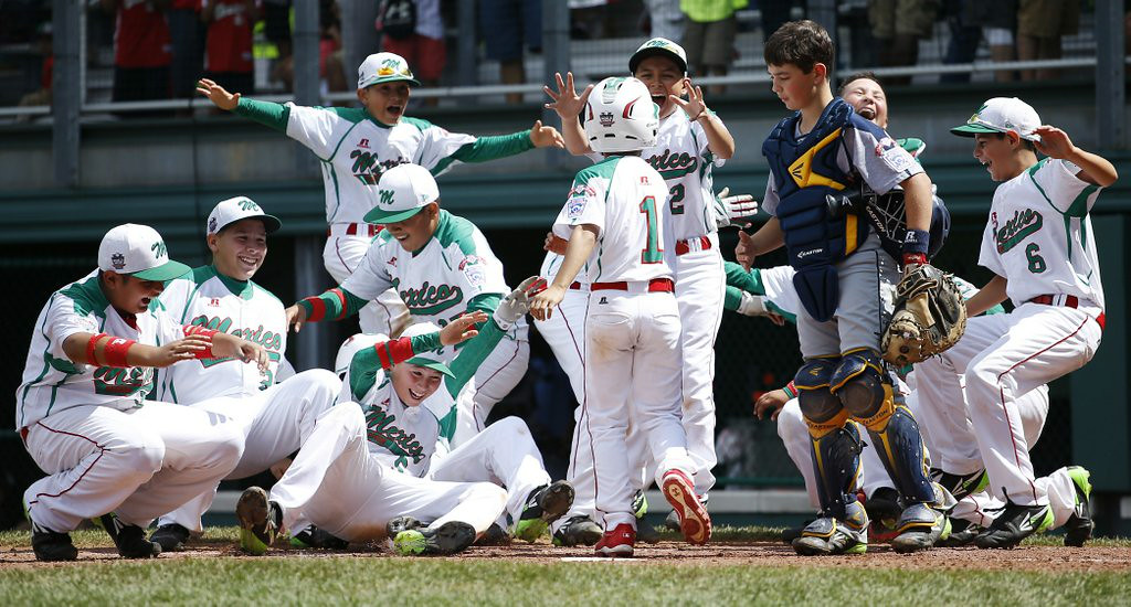 ". <p><b> Mexico�s 4-foot-8 Ruy Martinez hit a towering home run at the Little League World Series on Monday, after which he was � </b> </p><p> A. Mobbed by teammates at home plate </p><p> B. Interviewed by ESPN and Univision </p><p> C. Suspended for steroid use </p><p><b><a href=""http://www.cbssports.com/mlb/eye-on-baseball/24666524/-foot-8-ruy-martinez-bombs-it-to-dead-center-in-llws\"" target=\""_blank\"">LINK</a></b> </p><p>  (AP Photo/Matt Slocum)</p>"