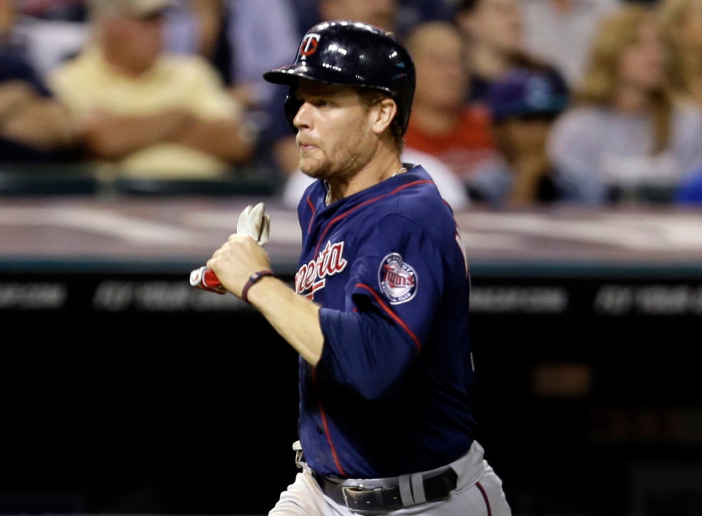 . Minnesota\'s Justin Morneau hustles home on a two-RBI double from Josh Willingham in the seventh inning against the Indians. (AP Photo/Tony Dejak)