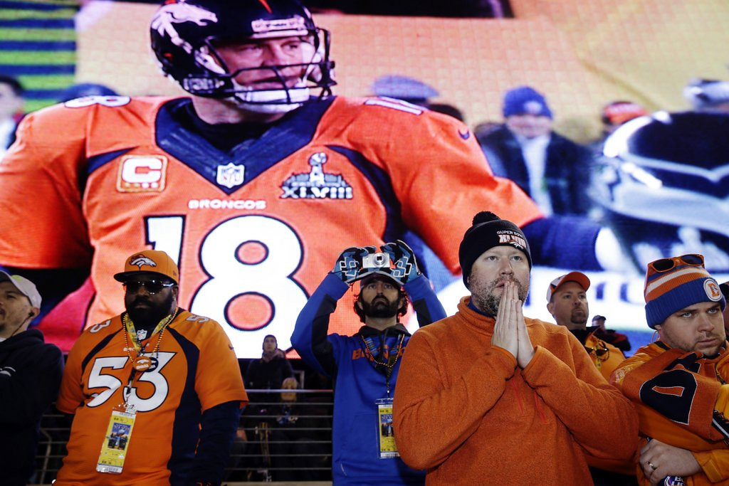 """. <p><b> Most fans watching Denver�s Peyton Manning during Sunday�s Super Bowl XLVIII came to the quick conclusion that he was not the best quarterback � </b> <p> A. In NFL history <p> B. In the league today <p> C. On the field at the Meadowlands <p><b><a href=\'http://www.twincities.com/ci_25048415/seattle-dominates-denver-win-super-bowl-xlviii\' target=\""""_blank\"""">HUH?</a></b> <p>    (AP Photo/Seth Wenig)"""