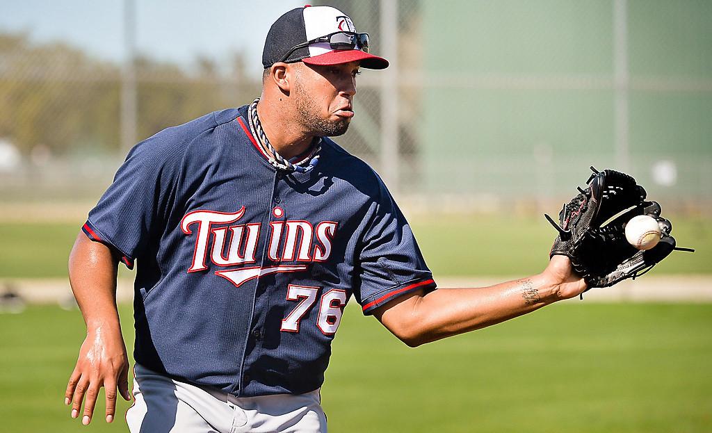 . Non-roster pitcher Deolis Guerra catches a toss to first. (Pioneer Press: Ben Garvin)