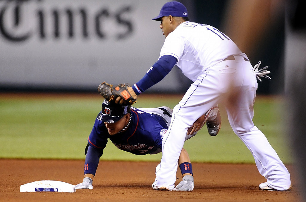 . Tampa Bay Rays shortstop Yunel Escobar, right, beats Minnesota Twins\' Oswaldo Arcia to the plate for the out at second base as Arcia attempts to advance on the play during the fourth inning.(AP Photo/Brian Blanco)