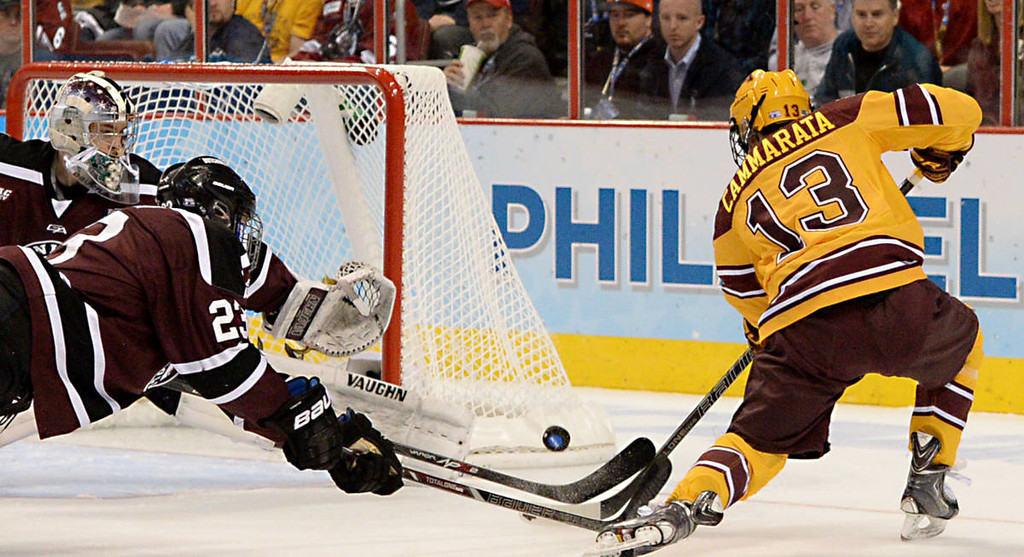 . Minnesota freshman forward Taylor Cammarata tries to score another goal against Union College junior goalie Colin Stevens in the second period of the NCAA Frozen Four Championship Game at the Wells Fargo Center in Philadelphia, Saturday, April 12, 2014.  (Pioneer Press: John Autey)