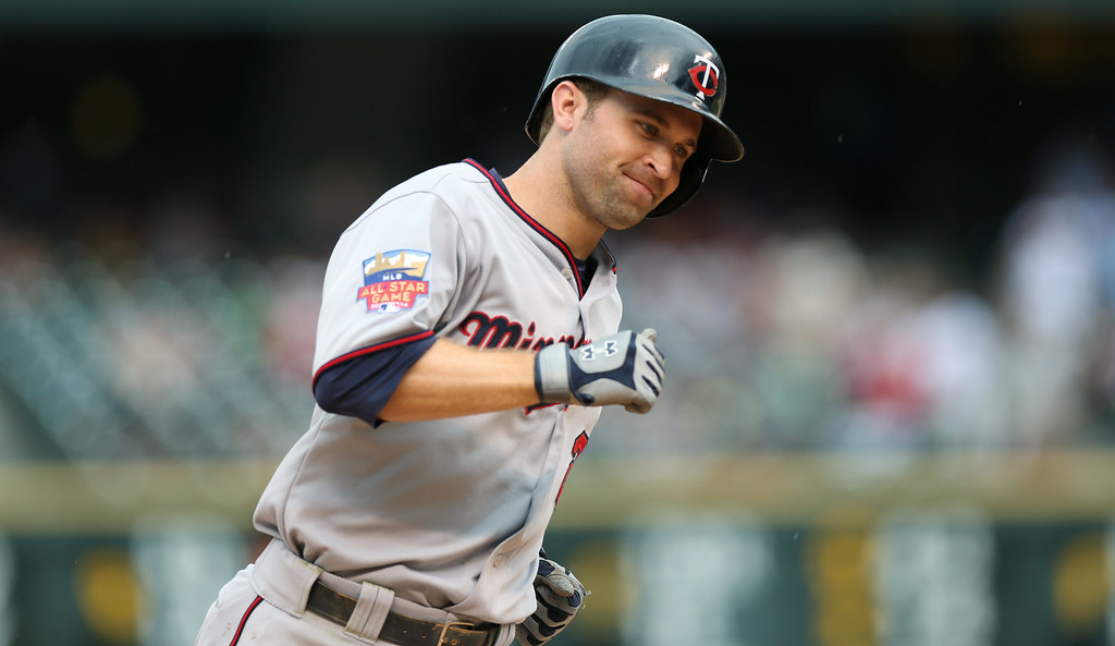 . Minnesota Twins\' Brian Dozier circles the bases after hitting a three-run home run against the Colorado Rockies in the ninth inning. (AP Photo/David Zalubowski)