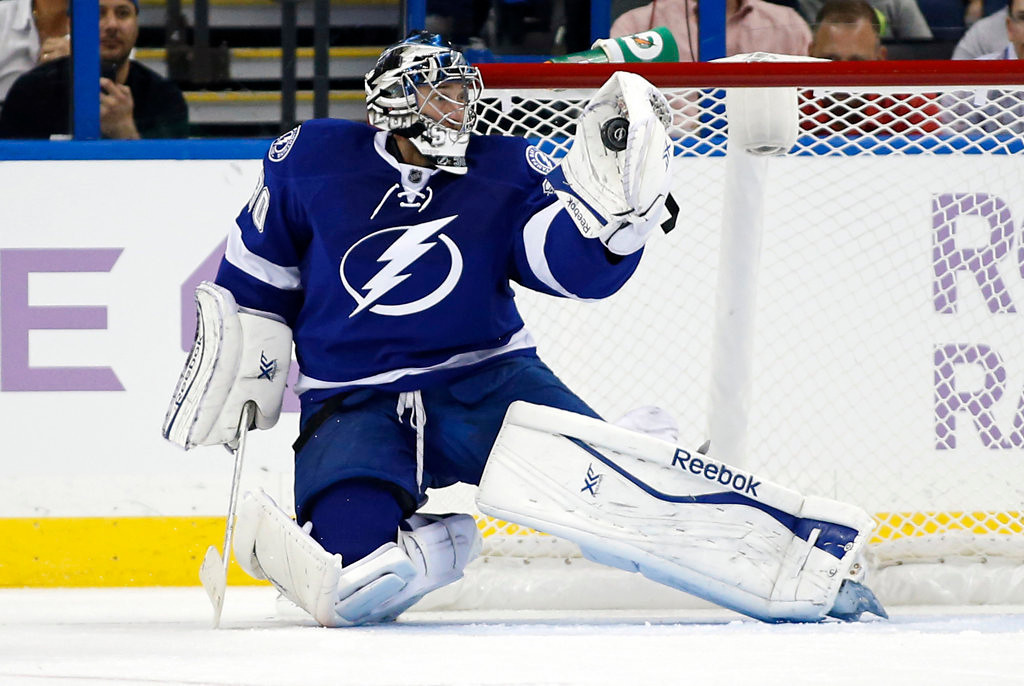 . Ben Bishop #30 of the Tampa Bay Lightning makes a save against the Minnesota Wild. (Photo by Mike Carlson/Getty Images)