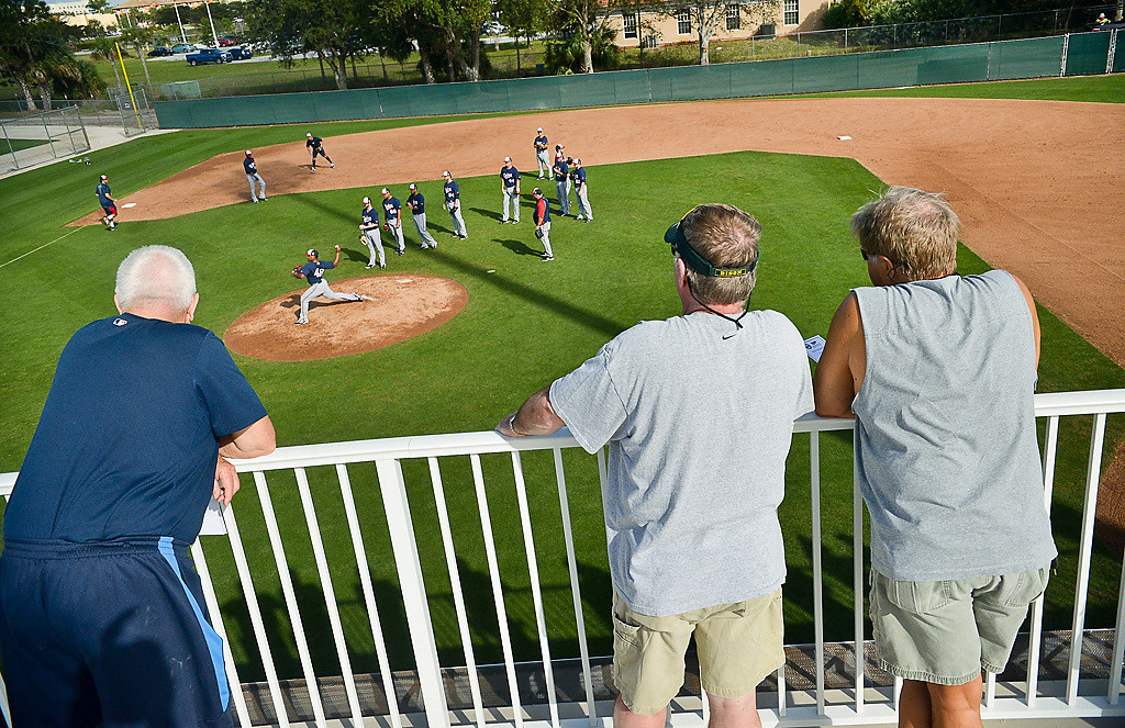 . Fans lean on the rail overlooking Field Six as pitchers field grounders. (Pioneer Press: Ben Garvin)