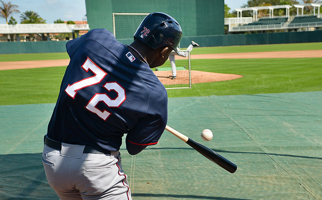 . Rookie Miguel Sano tattoos a pitch from Glen Perkins during BP.  (Pioneer Press: Ben Garvin)