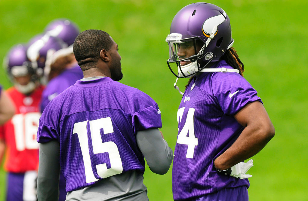 . Wide receivers Greg Jennings, left, and rookie Cordarrelle Patterson take a break during practice at Winter Park on Wednesday.  (Pioneer Press: Scott Takushi)