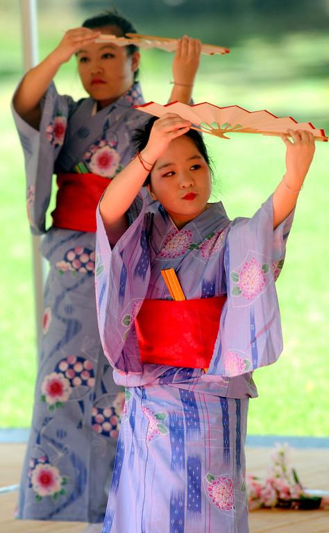 . Sansei Yonsei Kai dancers Shoua Yang, foreground, and Kao Lai Lee perform for Dragon Festival spectators. (Pioneer Press: Sherri LaRose-Chiglo)