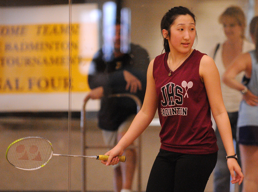 . Johnson High School\'s Ka Lia Her looks back at her opponent, Harding\'s Panyia Vue, as the pair compete in the championship individual match.  (Pioneer Press: John Autey)