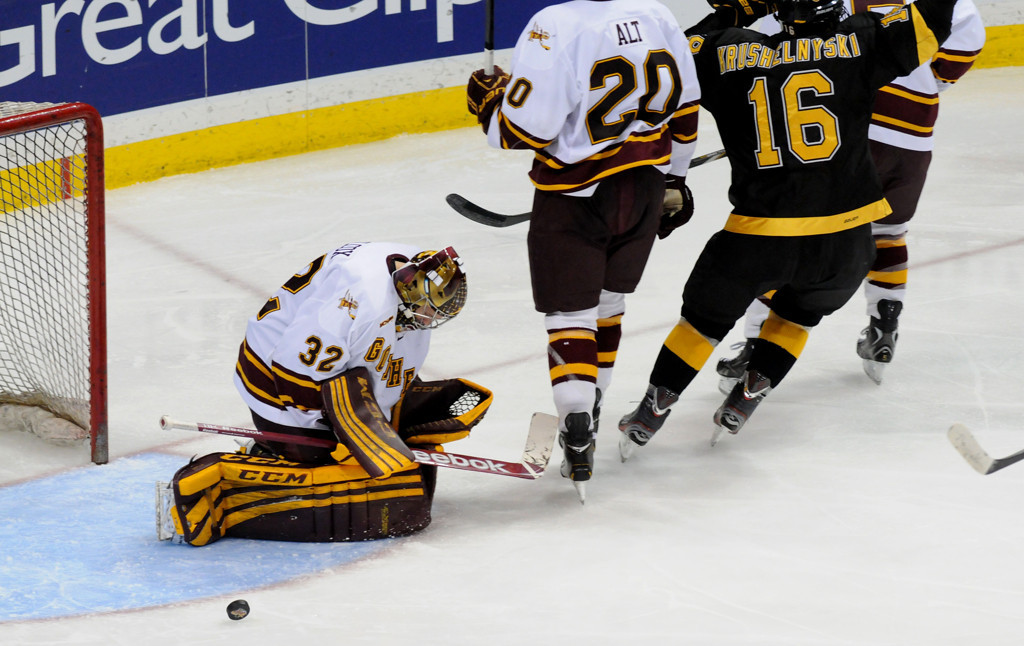 . Minnesota goaltender Adam Wilcox looks down as the puck comes out of the goal after College Colorado\'s Charlie Taft scores during second period of the WCHA Final Five at the Xcel Energy Center Arena on March 22, 2013. Colorado\'s Alexander Krushelnyski (16)  celebrates. (Pioneer Press: Sherri LaRose-Chiglo)