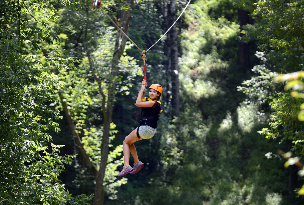 . Osceola, Wisconsin resident Sarah Thorsland, 13, enjoys a ride down the fastest zip line, where speeds reach about 35 mph at the Aerial Adventure Park at Trollhaugen in Dresser, Wisconsin, Saturday, August 17, 2013.   (Pioneer Press: Chris Polydoroff)