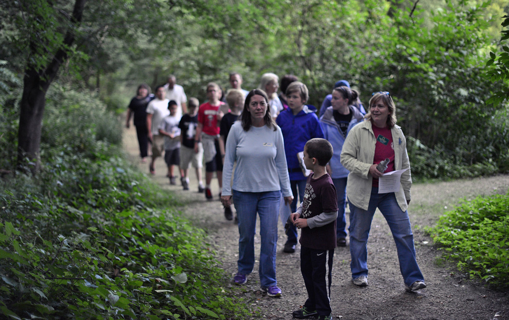 . Naturalist Carole Gernes, right, leads a group of about 15 people on a bat outing at Maplewood Nature Center.  (Pioneer Press: Chris Polydoroff)