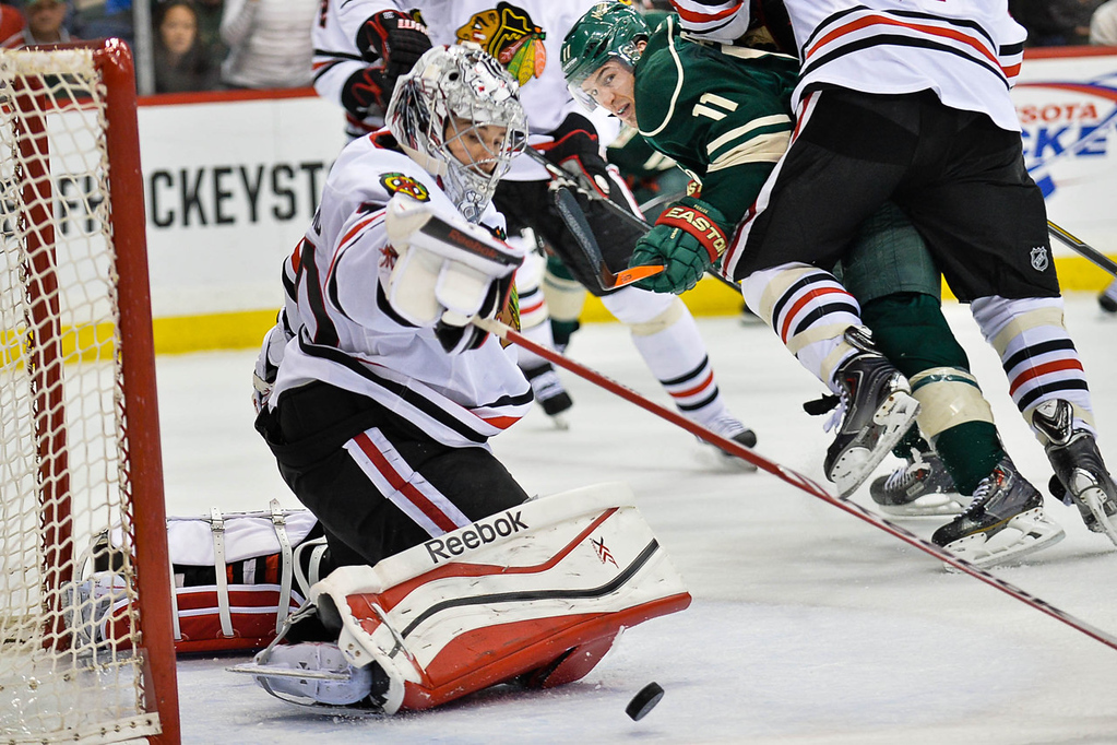 . Blackhawks goalie Corey Crawford stops a shot during the second period against the Wild.  (Pioneer Press: Ben Garvin)