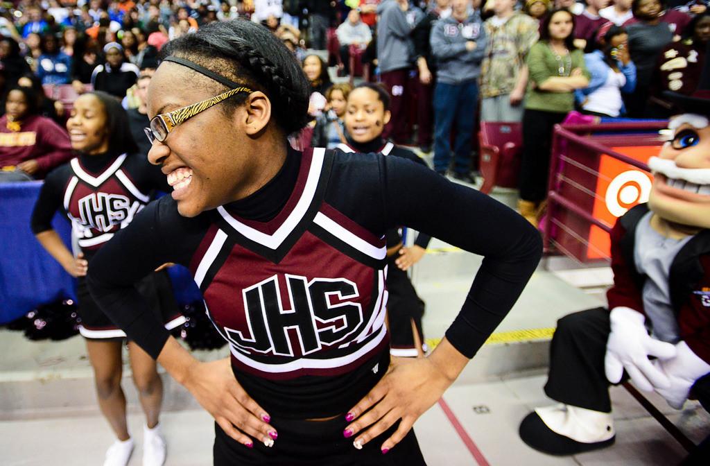 . St. Paul Johnson cheerleader Vontayia McKinley, 17 of St. Paul cheers during the game. (Pioneer Press: Ben Garvin)