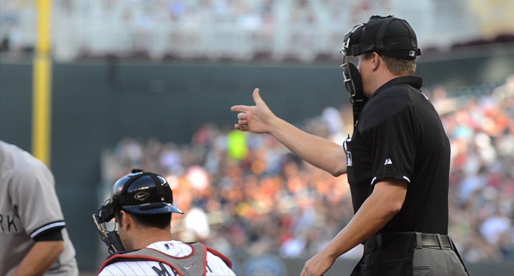 . Home plate umpire Cory Blaser motions to Twins starting pitcher Samuel Deduno to deliver to start the game against the Yankees. (Pioneer Press: C.J. Sinner)