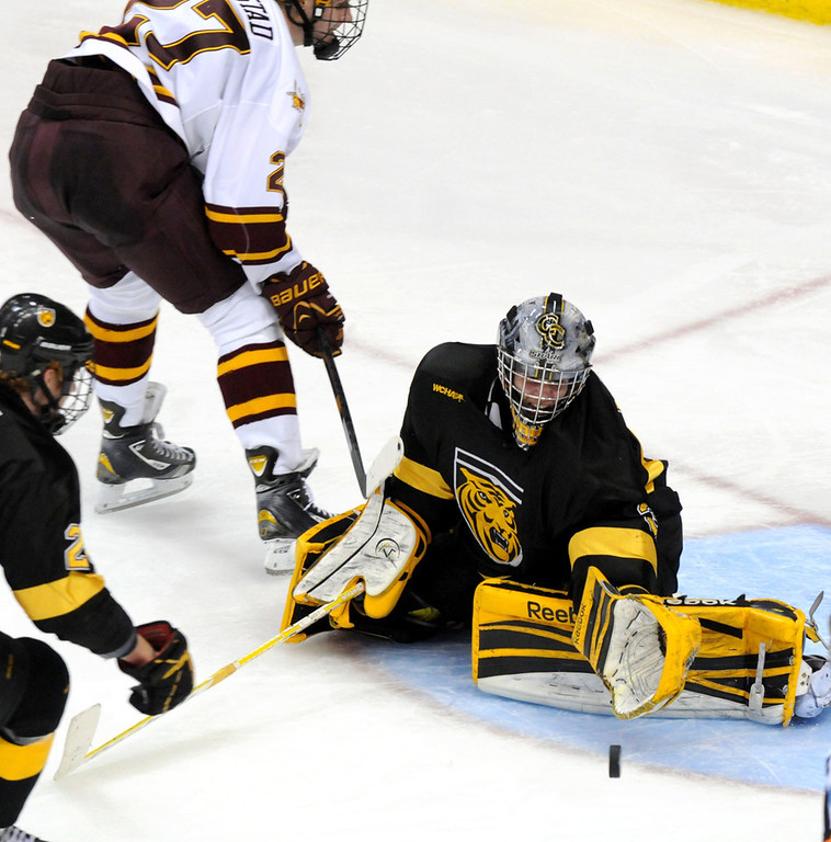 . Colorado College goaltender Joe Howe stops the puck off a shoot by Minnesota\'s Nick Bjugstad during the second period of the WCHA Final Five semifinals at the Xcel Energy Center Arena on March 22, 2013. (Pioneer Press: Sherri LaRose-Chiglo)