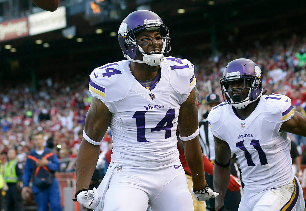 . Minnesota Vikings wide receiver Joe Webb (14) celebrates after catching a three-yard touchdown with wide receiver Stephen Burton (11) during the third quarter of an NFL preseason football game against the San Francisco 49ers in San Francisco, Sunday, Aug. 25, 2013. (AP Photo/Marcio Jose Sanchez)
