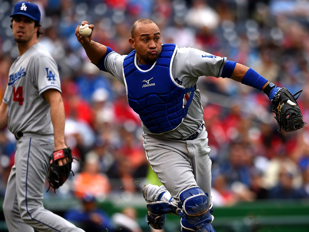 ". <p><b> The Los Angeles Dodgers waived minor league catcher Miguel Olivo last week after he committed the cardinal sin of � </b> <p> A. Fighting a teammate in the dugout and biting his ear <p> B. Criticizing his manager in the media  <p> C. Hitting less than Aaron Hicks <p><b><a href=\' http://www.twincities.com/sports/ci_25820117/dodgers-release-catcher-miguel-olivo-after-minor-league\' target=""_blank\"">LINK</a></b> <p>   (Patrick Smith/Getty Images)"
