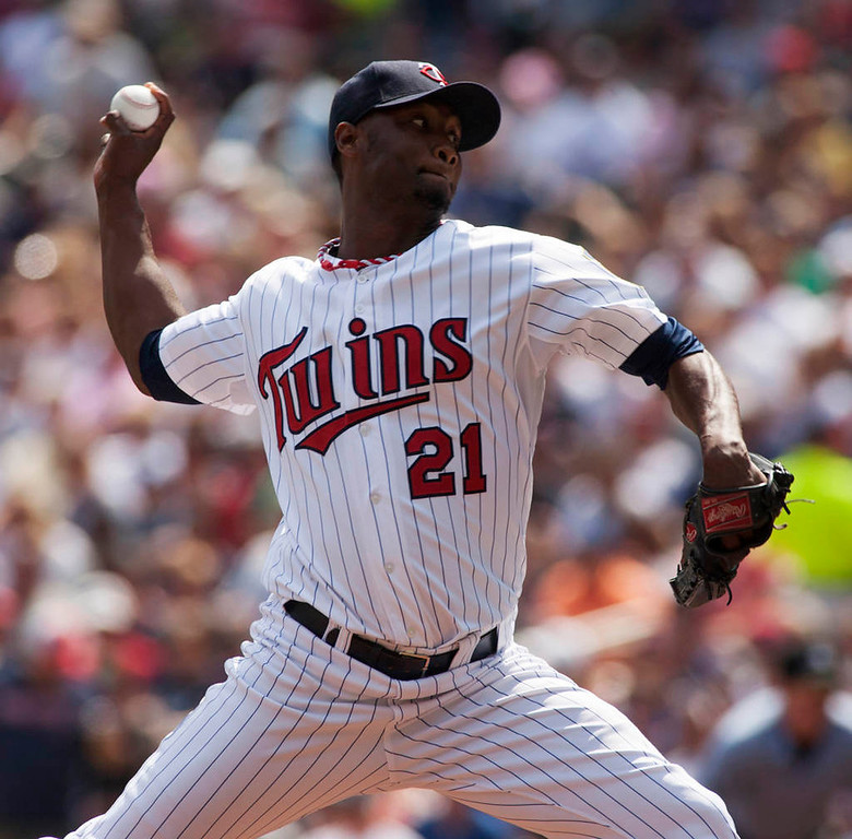 . Minnesota Twins starting pitcher Samuel Deduno delivers against the Chicago White Sox during the first inning.(AP Photo/Paul Battaglia)